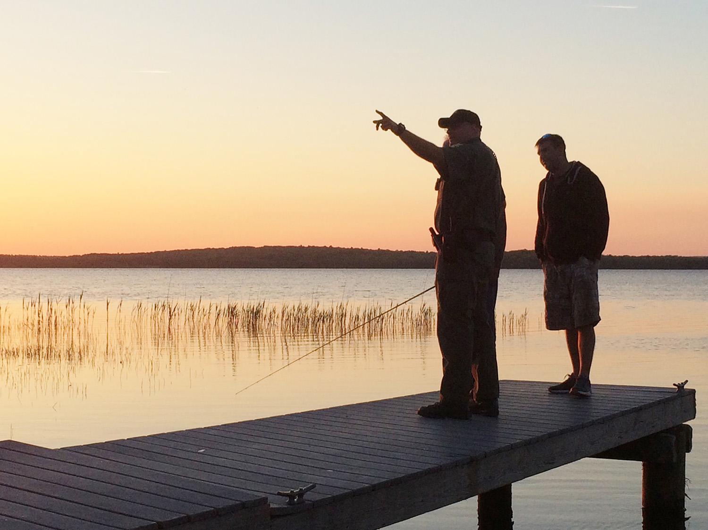 Officer Schipritt assisting fishermen at Worden Pond